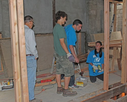 People working on building house