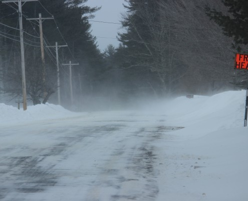 Frost Heaves snow covered road